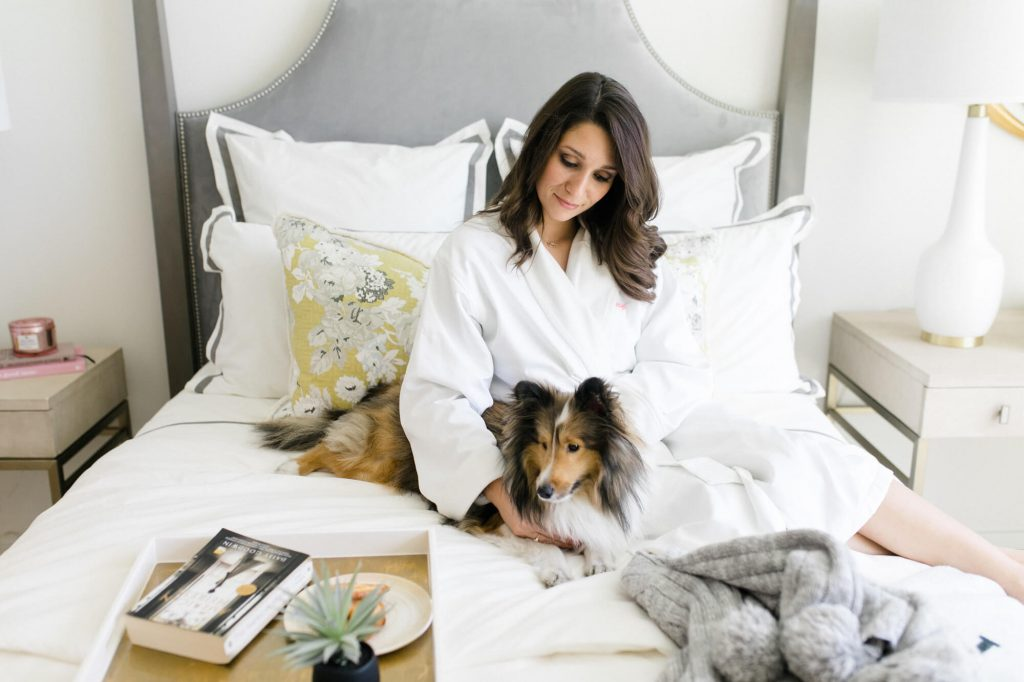 THEA lavish luxury lady relaxing with dog