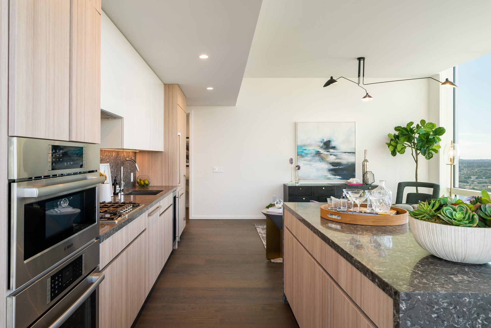 Downtown Los Angeles Residences - THEA at Metropolis Open Kitchen with Island, Stainless Steel Appliances, and High-End Finishes
