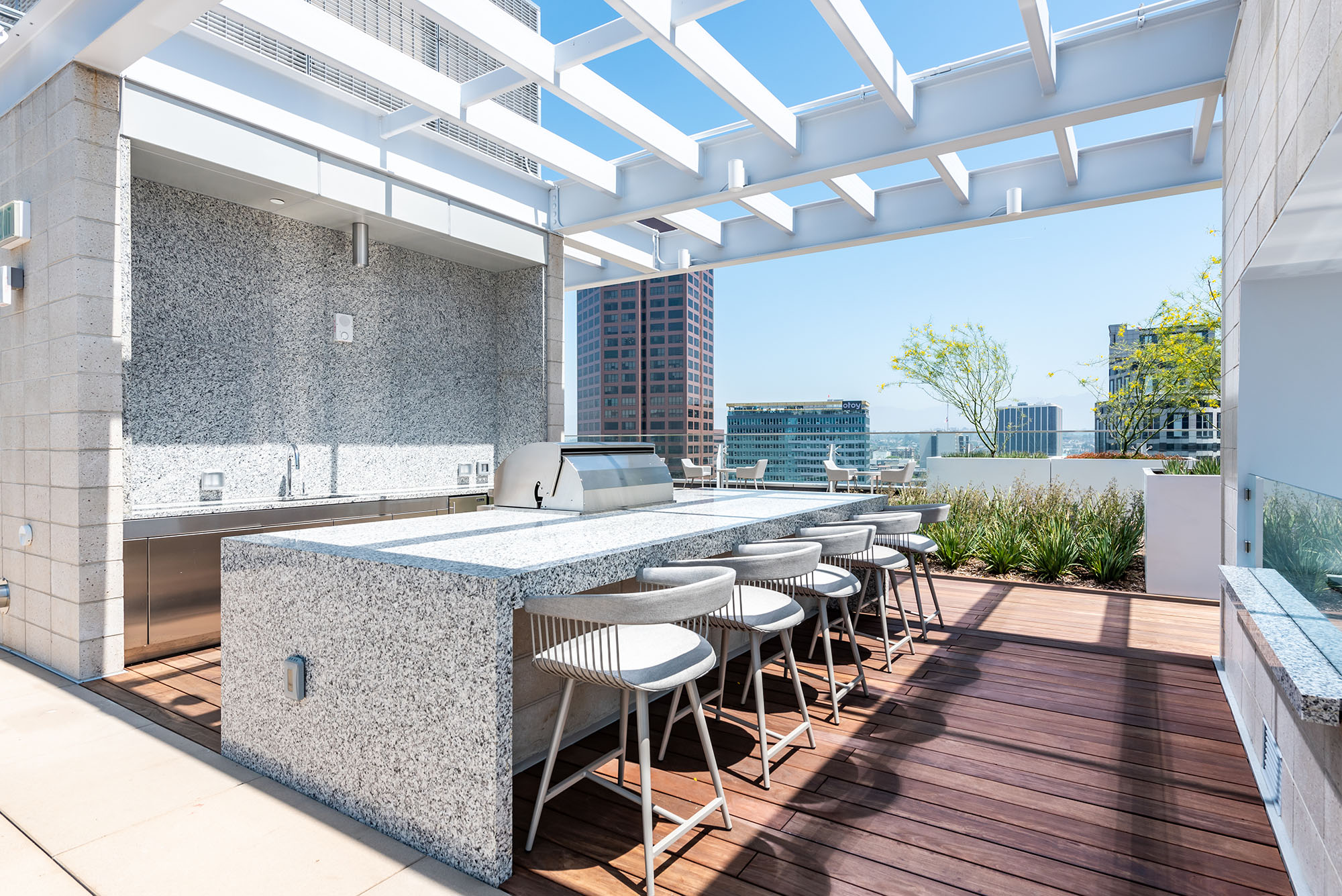 Dog Friendly Residences in Downtown Los Angeles, CA - THEA at Metropolis Rooftop BBQ Lounge with City Views and Table Seating