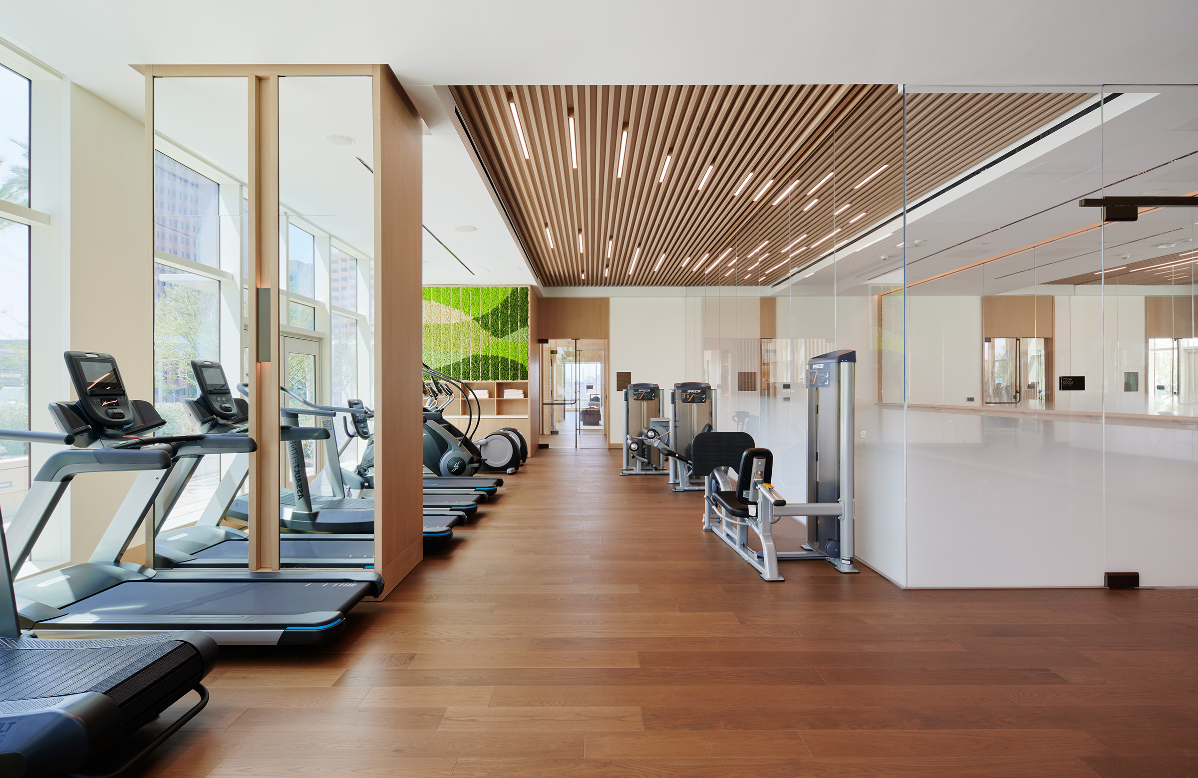Luxury Residences in Downtown Los Angeles CA - State-of-the-Art Fitness Center with Stylish Interiors and Various Gym Equipment